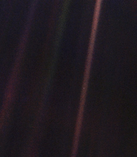 Earth, shown faintly in space