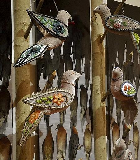 Artwork featuring beaded birds