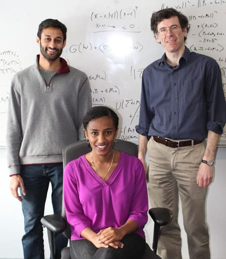 Gradstudents in front of white board.