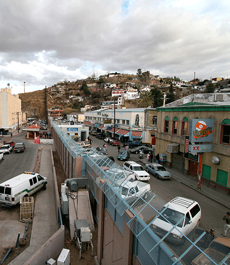 Border wall with vans and buildings