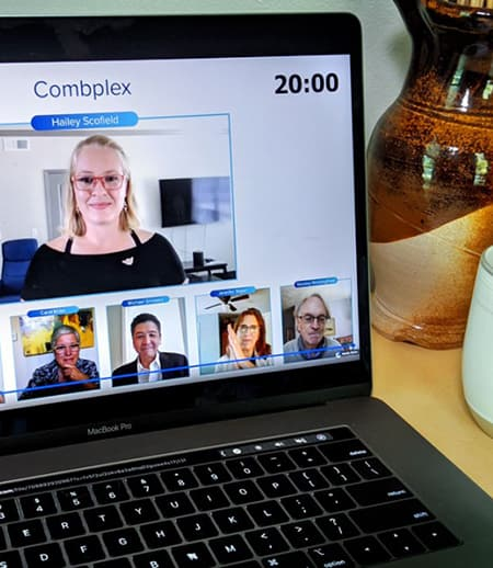 Computer showing five people in screen shots