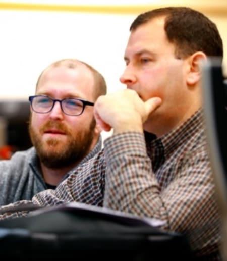 Professors at computer