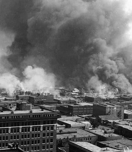 Historic photo: Smoke billows beyond city buildings