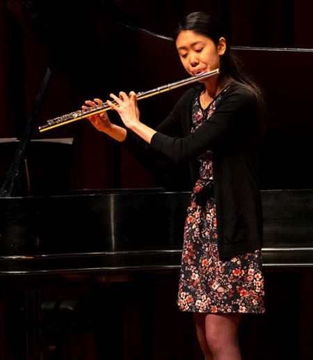 Joy Zhang playing the flute