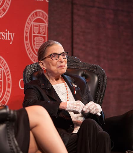 Ruth Bader Ginsburg seated in a chair