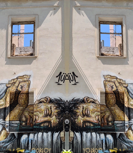 Mural of homeless man sleeping on building