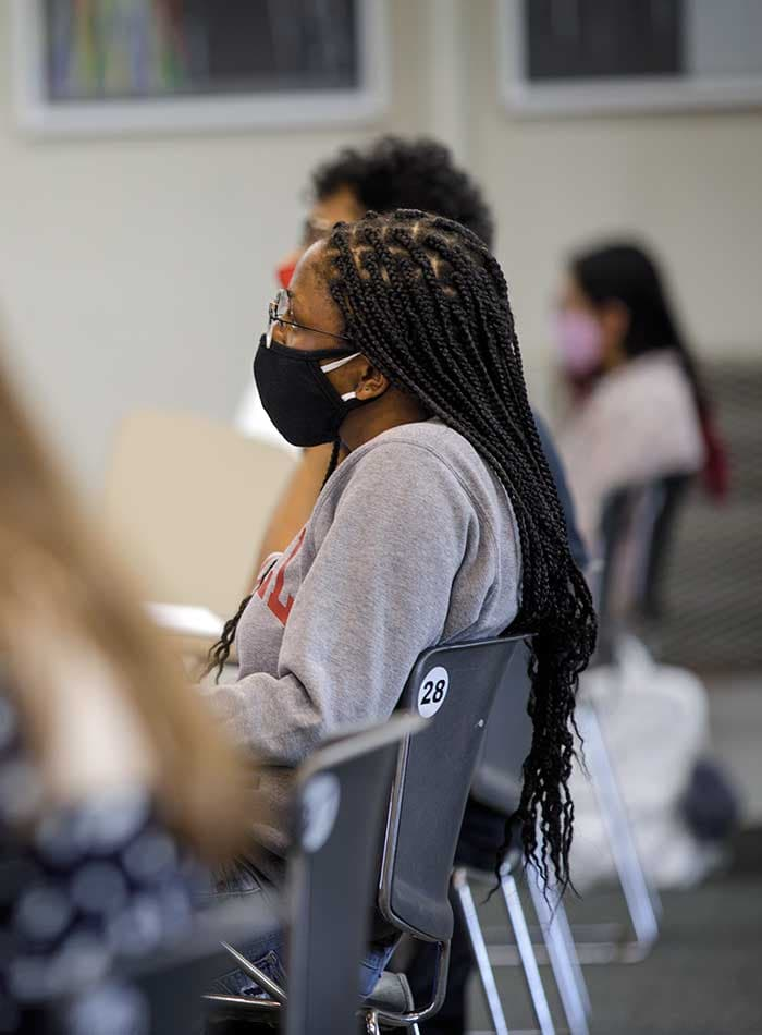 Student in mask in classroom