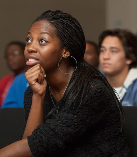 Female Black student listening to talk