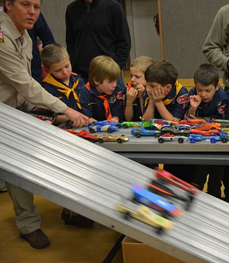 Boy Scouts at a pinewood derby car race