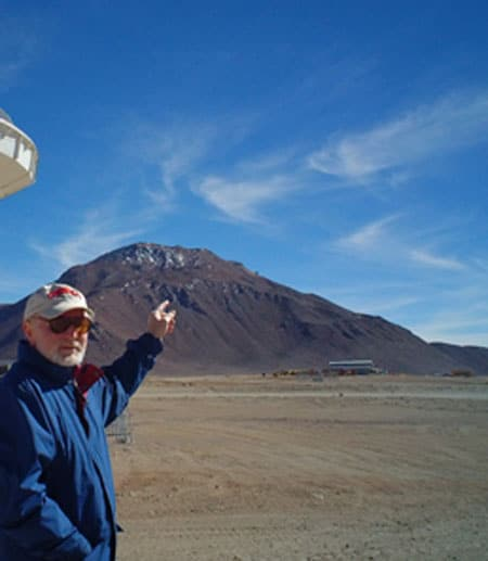 Riccardo Giovanelli pointing at site for telescope