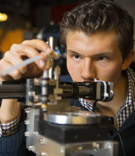Undergraduate student using scientific instrument