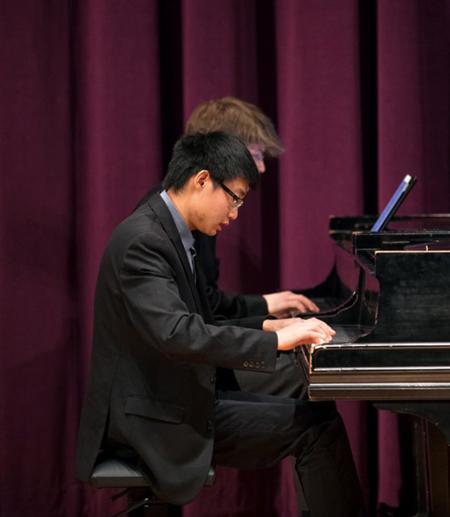 Sheng playing piano