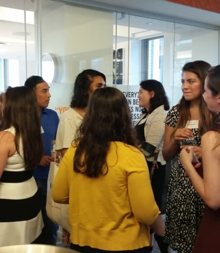 Students at an alumni networking event