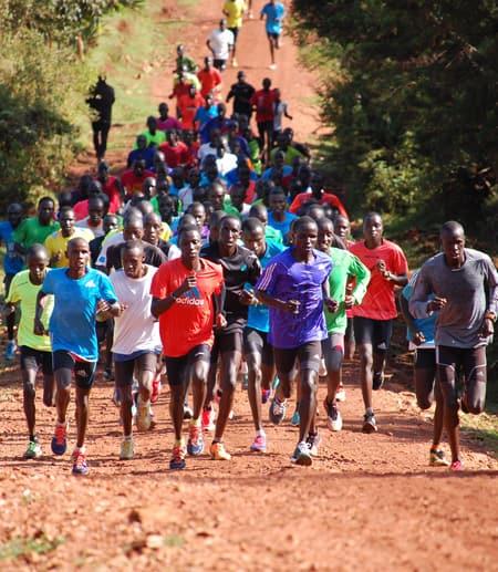 Teenagers running on road in Kenya