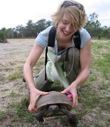 Graduate student with tortoise during field course