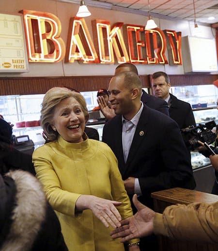 Hillary Clinton shaking hands in bakery