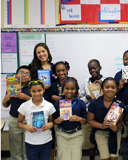 "Kathryn Ling '11, upper left, a Teach for America corps member and founder of Light in the Attic, with her fourth-grade class and their current ""reads"" at Hazlehurst Pre-K-8 School in Mississippi."