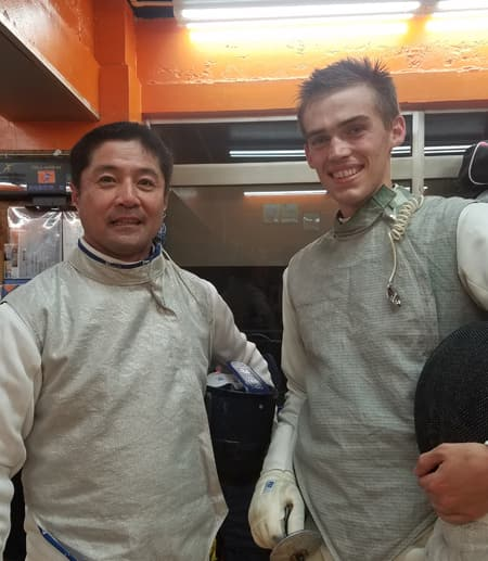 Students in fencing uniforms
