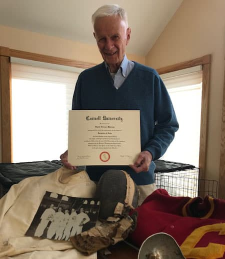 Murray poses with some of his Cornell memorabilia