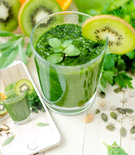Glass of green juice, fruit