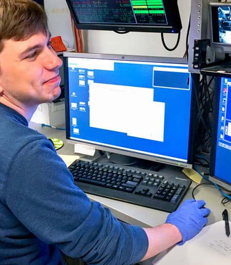 William Thomas, a graduate student in the field of chemistry and chemical biology, collects data on ribonucleotide reductase.