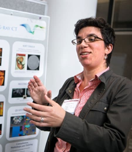 Teresa Porri, CT manager for Cornell's Institute of Biotechnology, discusses her poster illustrating the Biotechnology Resource Center's Imaging Facilities