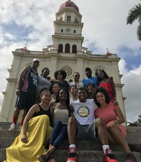 Students on steps of building in Cuba