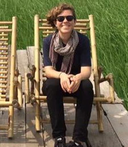 Person wearing sunglasses, sitting in chair