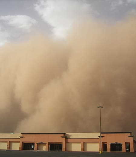 A dust storm engulfs a building
