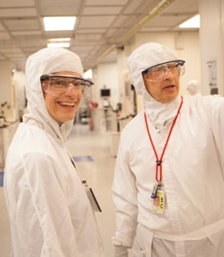 student wearing protective clothing in lab
