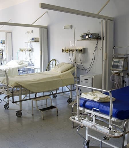 Row of empty hospital beds