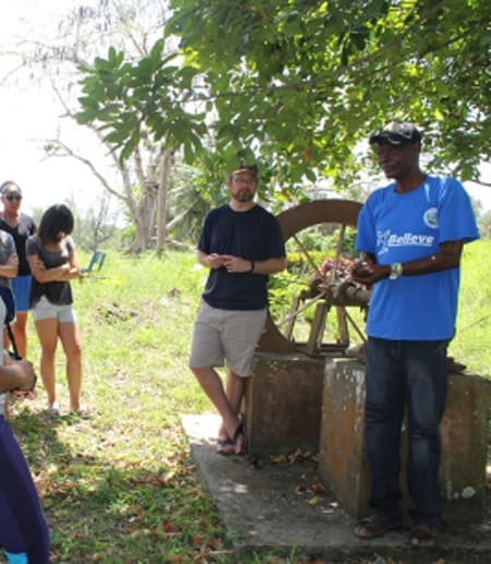Students working with a local community member in Jamaica