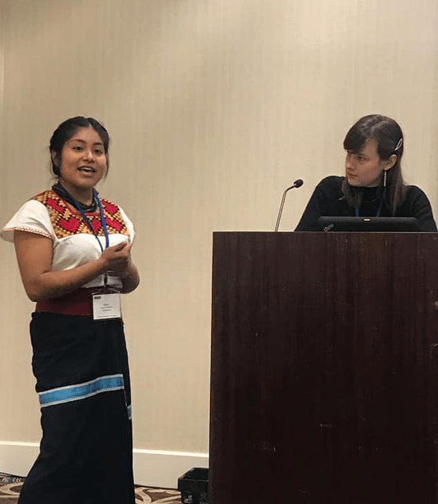 Carol-Rose Little and Morelia Vázquez Martínez presenting their research.