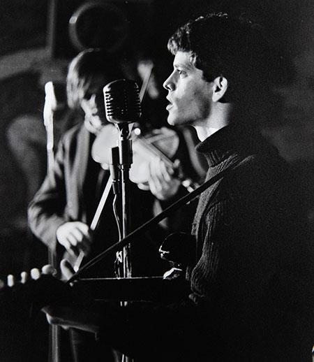 Lou Reed playing guitar