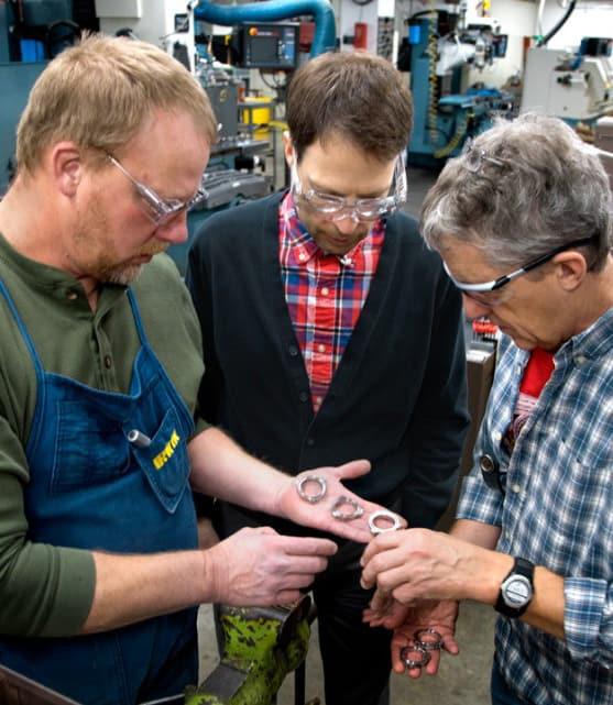 faculty looking at parts