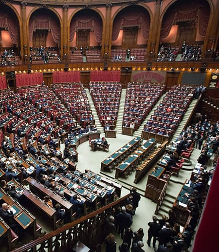 Huge room of the Italian Parliament, with seats half-empty