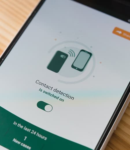Phone showing contact tracing app