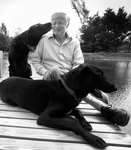 James McConkey, professor of English, with dogs.