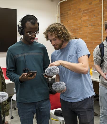 Milstein student with Sam Harnett and audio equipment