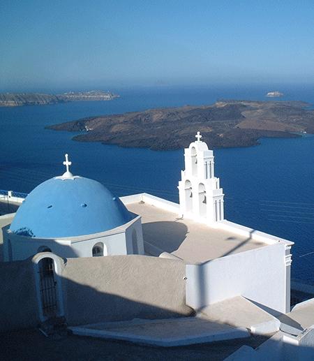 White Greek building against a blue sea: island of Santorini