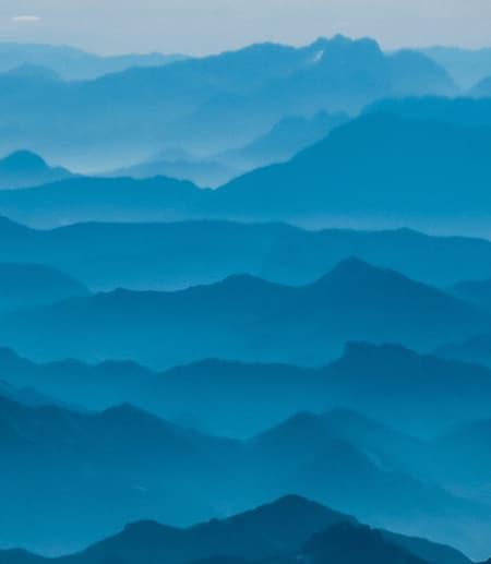 Blue mountains recede into the distance