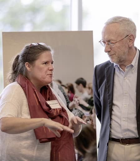 Kelly Zamudio, left, Goldwin Smith Professor of Ecology and Evolutionary Biology, and Provost Michael Kotlikoff chat at the Provost's Seminar on Teaching and Learning April 18 at the Statler Hotel.