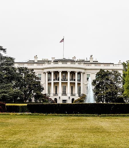 Pillars of the White House seen from across a lawn