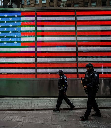 giant American flag with two police officers