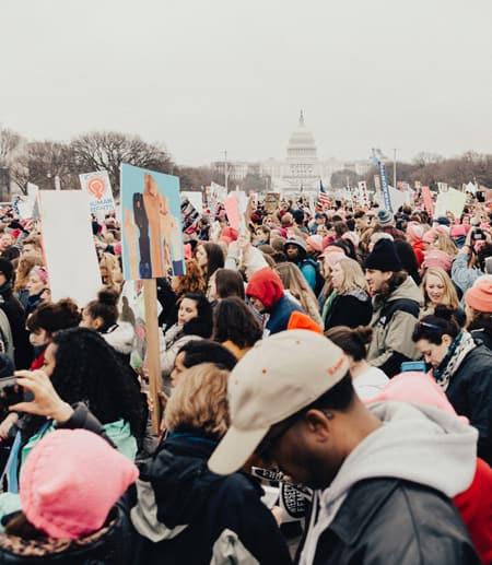 Crowds at a march in Washington DC. Photo credit: @royaannmiller/Unsplash