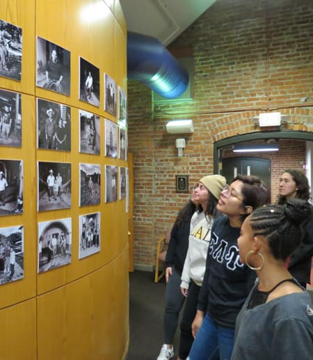Students view the Stateless to Citizen exhibit in Rockefeller Hall