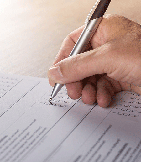 Hand with pencil, marking a ballot