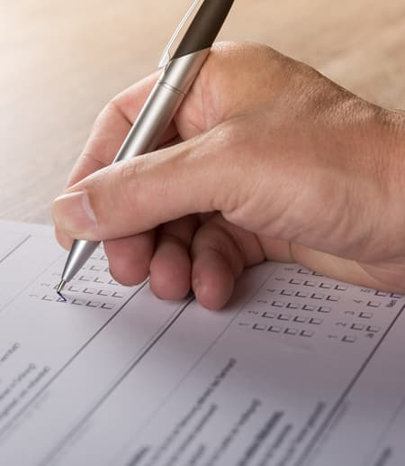 Hand filling in form