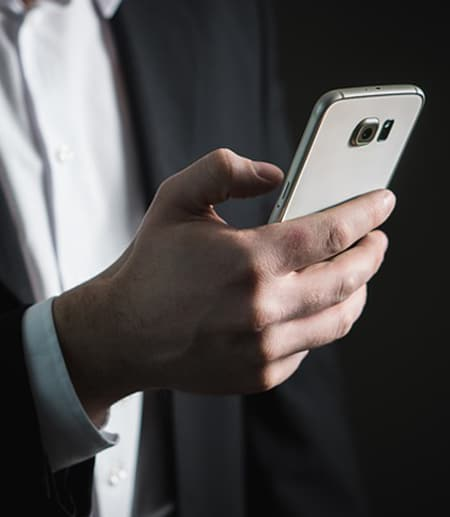 A hand texting on a phone