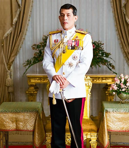 Thai king posed with a sword and full military uniform